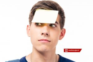 Closeup portrait of a man with sticker on forehead isolated on a white background. Looking away