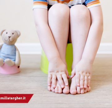 close-up of legs of the child sitting on the potty